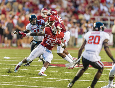 Arkansas running back Rawleigh Williams (22) carries during a football game between the Arkansas Razorbacks and the Texas Tech Red Raiders at Reynolds Razorback Stadium at the University of Arkansas in Fayetteville, Arkansas.   Texas Tech won 35-24.  (Alan Jamison, Nate Allen Sports Service)