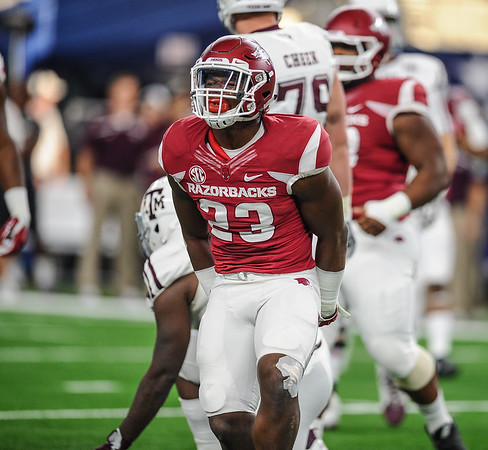 Linebacker Dre Greenlaw (23) celebrates a tackle during the Southwest Classic game between the Arkansas Razorbacks and the Texas A&M Aggies at AT&T Stadium in Arlington, Texas.   (Alan Jamison, Nate Allen Sports Service)
