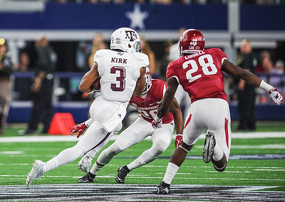 Arkansas Razorbacks defensive back Rohan Gaines (26) and Arkansas Razorbacks defensive back Josh Liddell (28) attempt to tackle Texas A&M Aggies wide receiver Christian Kirk (3) during the Southwest Classic game between the Arkansas Razorbacks and the Texas A&M Aggies at AT&T Stadium in Arlington, Texas.   (Alan Jamison, Nate Allen Sports Service)