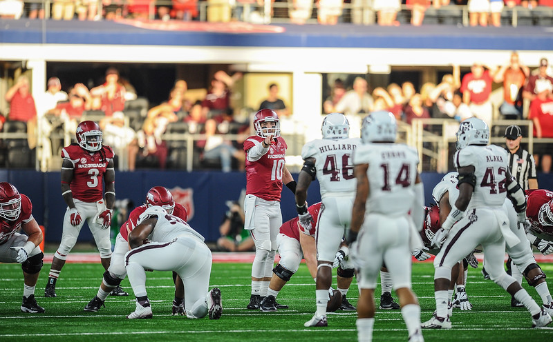 Quarterback Brandon Allen (10) calls out the defense during the Southwest Classic game between the Arkansas Razorbacks and the Texas A&M Aggies at AT&T Stadium in Arlington, Texas.   (Alan Jamison, Nate Allen Sports Service)
