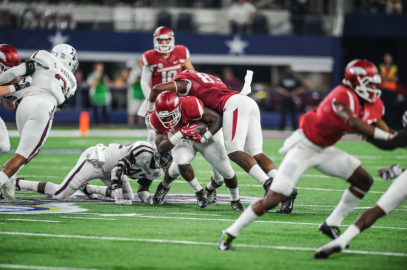 Arkansas Razorbacks running back Rawleigh Williams (22) rushed for 46 yards including one touchdown during the Southwest Classic game between the Arkansas Razorbacks and the Texas A&M Aggies at AT&T Stadium in Arlington, Texas.   (Alan Jamison, Nate Allen Sports Service)