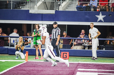 Texas A&M Aggies wide receiver Christian Kirk (3) scores during the Southwest Classic game between the Arkansas Razorbacks and the Texas A&M Aggies at AT&T Stadium in Arlington, Texas.  Texas A&M won 28-21 in overtime.   (Alan Jamison, Nate Allen Sports Service)