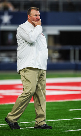 Head Coach Bret Bielema watches pre-game warmups during the Southwest Classic game between the Arkansas Razorbacks and the Texas A&M Aggies at AT&T Stadium in Arlington, Texas.   (Alan Jamison, Nate Allen Sports Service)