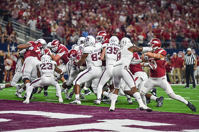 Rawleigh Williams scores his first Arkansas touchdown during the Southwest Classic game between the Arkansas Razorbacks and the Texas A&M Aggies at AT&T Stadium in Arlington, Texas.  Texas A&M won 28-21 in overtime.   (Alan Jamison, Nate Allen Sports Service)