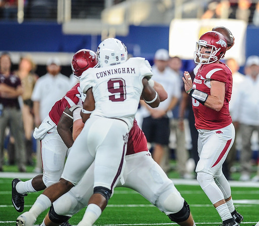Arkansas Razorbacks quarterback Brandon Allen (10) passes during the Southwest Classic game between the Arkansas Razorbacks and the Texas A&M Aggies at AT&T Stadium in Arlington, Texas.   (Alan Jamison, Nate Allen Sports Service)
