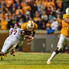 Arkansas Razorbacks defensive lineman Tevin Beanum (97) tacklesTennessee Volunteers quarterback Joshua Dobbs (11) during a football game between the Arkansas Razorbacks and the Tennessee Volunteers at Neyland Stadium in Knoxville, Tennesee.     Arkansas won 24-20.  (Alan Jamison, Nate Allen Sports Service)