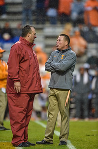 Head coaches Bret Bielema and Butch Jones talk before a rainy football game between the Arkansas Razorbacks and the Tennessee Volunteers at Neyland Stadium in Knoxville, Tennesee.     Arkansas won 24-20.  (Alan Jamison, Nate Allen Sports Service)