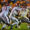Sebastian Tretola (73) and Mitch Smothers (65) protect Brandon Allen (10) during a football game between the Arkansas Razorbacks and the Tennessee Volunteers at Neyland Stadium in Knoxville, Tennesee.     Arkansas won 24-20.  (Alan Jamison, Nate Allen Sports Service)