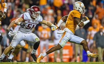 Arkansas linebacker Brooks Ellis (51) pursues Tennessee punt returner Cameron Sutton (7) during a football game between the Arkansas Razorbacks and the Tennessee Volunteers at Neyland Stadium in Knoxville, Tennesee.     Arkansas won 24-20.  (Alan Jamison, Nate Allen Sports Service)