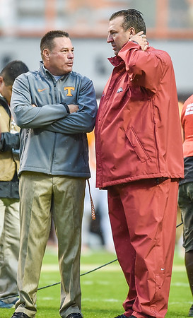 Head coaches meet before the football game between the Arkansas Razorbacks and the Tennessee Volunteers at Neyland Stadium in Knoxville, Tennesee.     The score was tied 17-17 at the half.  (Alan Jamison, Nate Allen Sports Service)