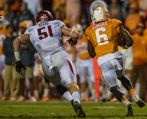 Arkansas linebacker Brooks Ellis (51) pursues Tennessee running back Alvin Kamara (6) 1during a football game between the Arkansas Razorbacks and the Tennessee Volunteers at Neyland Stadium in Knoxville, Tennesee.   Arkansas won 24-20.  (Alan Jamison, Nate Allen Sports Service)