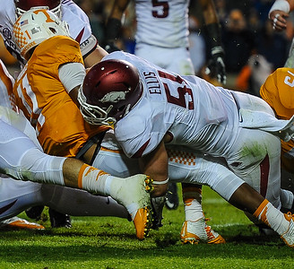 Arkansas linebacker Brooks Ellis (51) tackles Tennessee quarterback Joshua Dobbs (11) during a football game between the Arkansas Razorbacks and the Tennessee Volunteers at Neyland Stadium in Knoxville, Tennesee.        Arkansas won 24-20.  (Alan Jamison, Nate Allen Sports Service)