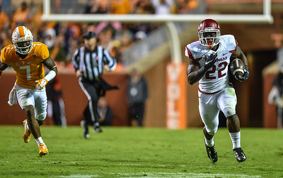 Arkansas Razorbacks running back Rawleigh Williams (22) carries during a football game between the Arkansas Razorbacks and the Tennessee Volunteers at Neyland Stadium in Knoxville, Tennesee.     The score was tied 17-17 at the half.  (Alan Jamison, Nate Allen Sports Service)