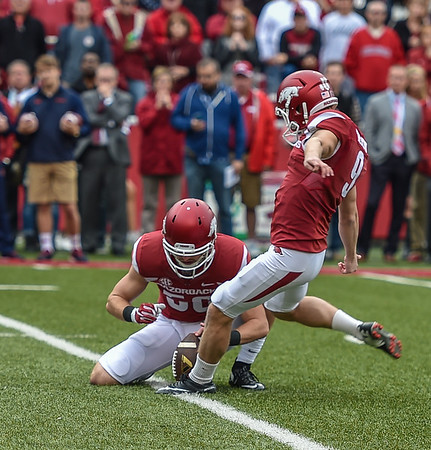 Arkansas Razorbacks kicker Cole Hedlund (9) with a point after during the football game between the Arkansas Razorbacks and the Auburn Tigers at Reynolds Razorback Stadium in Fayetteville, Arkansas.  Arkansas won 54-46 in four overtimes.  (Alan Jamison, Nate Allen Sports Service)