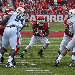 Arkansas Razorbacks running back Alex Collins (3) rushes during the football game between the Arkansas Razorbacks and the Auburn Tigers at Reynolds Razorback Stadium in Fayetteville, Arkansas.  Arkansas won 54-46 in four overtimes.  (Alan Jamison, Nate Allen Sports Service)