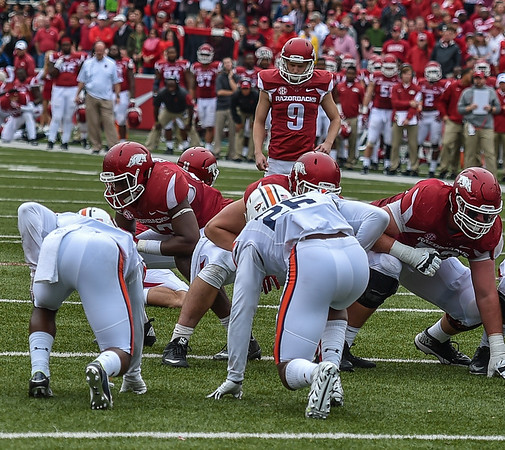 Arkansas Razorbacks kicker Cole Hedlund (9) with a point after touchdown during the football game between the Arkansas Razorbacks and the Auburn Tigers at Reynolds Razorback Stadium in Fayetteville, Arkansas.  Arkansas won 54-46 in four overtimes.  (Alan Jamison, Nate Allen Sports Service)