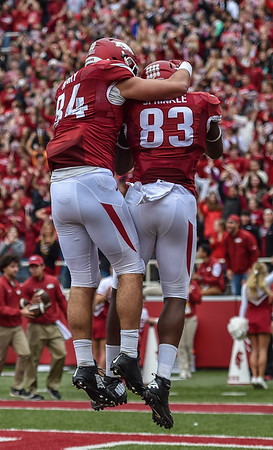 Hunter Henry (84) celebrates with Jeremy Sprinkle (83) after Sprinkle scored during the football game between the Arkansas Razorbacks and the Auburn Tigers at Reynolds Razorback Stadium in Fayetteville, Arkansas.  Arkansas led 14-7 at halftime. (Alan Jamison, Nate Allen Sports Service)