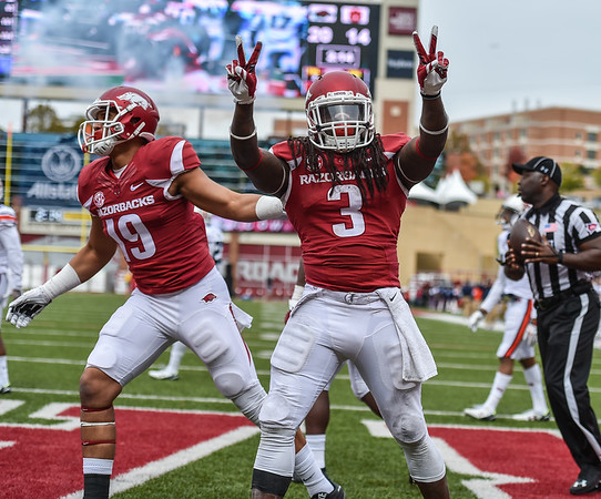 Arkansas Razorbacks running back Alex Collins (3) celebrates after a rushing touchdown during the football game between the Arkansas Razorbacks and the Auburn Tigers at Reynolds Razorback Stadium in Fayetteville, Arkansas.  Arkansas won 54-46 in four overtimes.  (Alan Jamison, Nate Allen Sports Service)