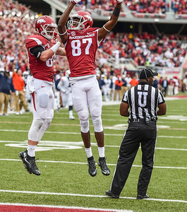 Arkansas Razorbacks wide receiver Dominique Reed (87) and Arkansas Razorbacks wide receiver Drew Morgan (80) celebrate Morgan's touchdown during the football game between the Arkansas Razorbacks and the Auburn Tigers at Reynolds Razorback Stadium in Fayetteville, Arkansas.  Arkansas won 54-46 in four overtimes.  (Alan Jamison, Nate Allen Sports Service)