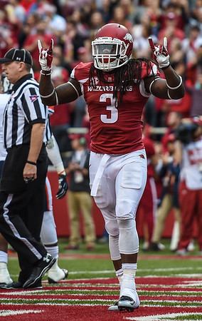 Alex Collins celebrates a rushing touchdown during a football game between the Arkansas Razorbacks and the UT Martin Skyhawks in Reynolds Razorback Stadium on October 31, 2015.   Arkansas led 35-14 at the half (Alan Jamison, Nate Allen Sports Service)