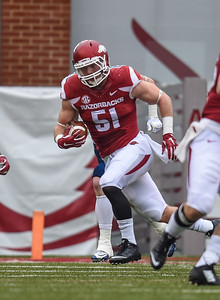 Brooks Ellis runs after an interception during a football game between the Arkansas Razorbacks and the UT Martin Skyhawks in Reynolds Razorback Stadium on October 31, 2015.   Arkansas led 35-14 at the half (Alan Jamison, Nate Allen Sports Service)