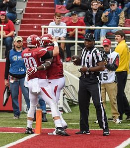 Drew Morgan celebrates with Alex Collins after Collins' rushing touchdown during a football game between the Arkansas Razorbacks and the UT Martin Skyhawks in Reynolds Razorback Stadium on October 31, 2015.   Arkansas led 35-14 at the half (Alan Jamison, Nate Allen Sports Service)