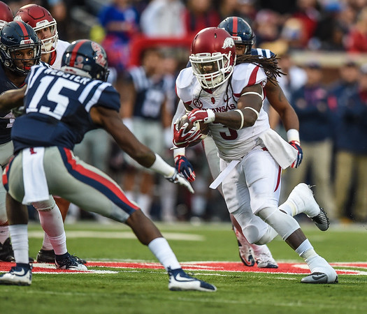 Razorback running back Alex Collins (3) rushes during a football game between Arkansas and Ole Miss on November 7, 2015.    (Alan Jamison, Nate Allen Sports Service)