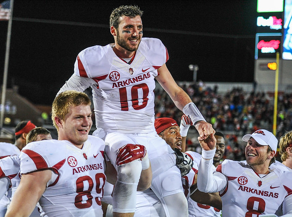 Brandon Allen celebrates with teammates after winning a football game between Arkansas and Ole Miss on November 7, 2015.  Arkansas won 53-52 in overtime.    (Alan Jamison, Nate Allen Sports Service)
