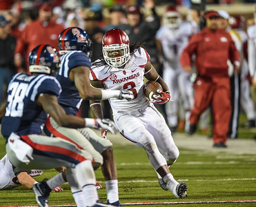 Razorback running back Alex Collins (3) with a miracle rush after receiving a lateral from Razorback tight end Hunter Henry (84) in overtime during a football game between Arkansas and Ole Miss on November 7, 2015.  Arkansas won 53-52 in overtime.    (Alan Jamison, Nate Allen Sports Service)