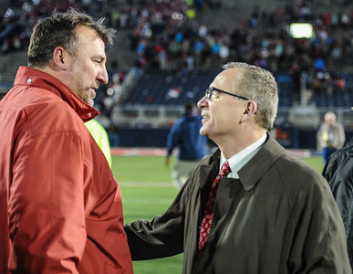 Head Coach Bret Bielema is congratulated by Athletic Director Jeff Long after winning a football game between Arkansas and Ole Miss on November 7, 2015.  Arkansas won 53-52 in overtime.    (Alan Jamison, Nate Allen Sports Service)