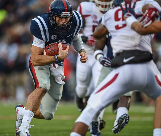 Ole Miss Rebels quarterback Chad Kelly (10) scores on a rushing play during a football game between Arkansas and Ole Miss on November 7, 2015.    (Alan Jamison, Nate Allen Sports Service)