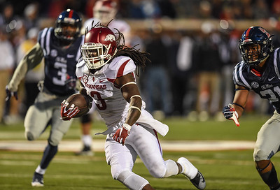 Razorback running back Alex Collins (3) rushes during a football game between Arkansas and Ole Miss on November 7, 2015.  Arkansas won 53-52 in overtime.    (Alan Jamison, Nate Allen Sports Service)