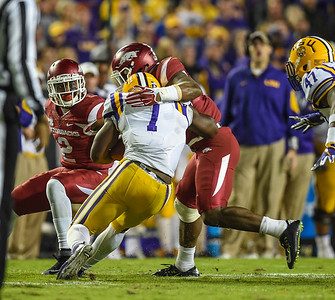 Arkansas Razorbacks linebacker Dre Greenlaw (23) and Arkansas Razorbacks defensive back D.J. Dean (2) stop LSU Tigers running back Leonard Fournette (7) during a football game between Arkansas and LSU on November 14, 2015.    (Alan Jamison, Nate Allen Sports Service)