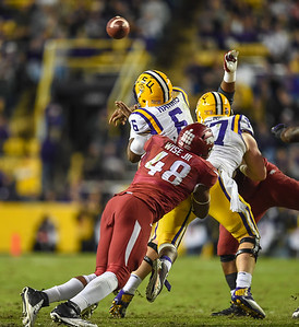 Arkansas Razorbacks defensive lineman Deatrich Wise Jr. (48) hurries LSU Tigers quarterback Brandon Harris (6) during a football game between Arkansas and LSU on November 14, 2015.    (Alan Jamison, Nate Allen Sports Service)