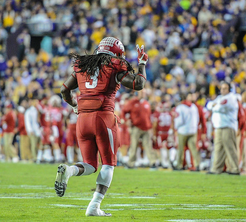 Arkansas Razorbacks running back Alex Collins (3) celebrates a touchdown during a football game between Arkansas and LSU on November 14, 2015.    (Alan Jamison, Nate Allen Sports Service)