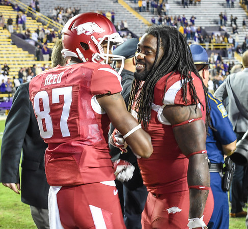 Arkansas Razorbacks wide receiver Dominique Reed (87) and Arkansas Razorbacks running back Alex Collins (3) celebrate after winning a football game between Arkansas and LSU on November 14, 2015.    (Alan Jamison, Nate Allen Sports Service)
