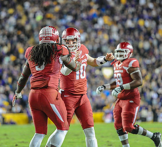 Arkansas Razorbacks running back Alex Collins (3) celebrates a touchdown with Arkansas Razorbacks quarterback Brandon Allen (10) during a football game between Arkansas and LSU on November 14, 2015.    (Alan Jamison, Nate Allen Sports Service)