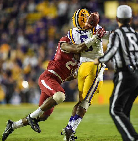 Arkansas Razorbacks linebacker Dre Greenlaw (23) forces a fumble during a football game between Arkansas and LSU on November 14, 2015.    (Alan Jamison, Nate Allen Sports Service)