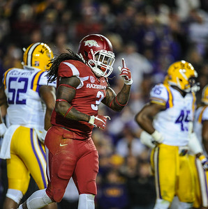 Arkansas Razorbacks running back Alex Collins (3) celebrates a rushing touchdown during a football game between Arkansas and LSU on November 14, 2015.    (Alan Jamison, Nate Allen Sports Service)