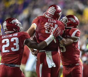 Arkansas Razorbacks linebacker Brooks Ellis (51) celebrates a fumble recovery with Arkansas Razorbacks linebacker Dre Greenlaw (23) and Arkansas Razorbacks defensive back Henre' Toliver (5) during a football game between Arkansas and LSU on November 14, 2015.    (Alan Jamison, Nate Allen Sports Service)