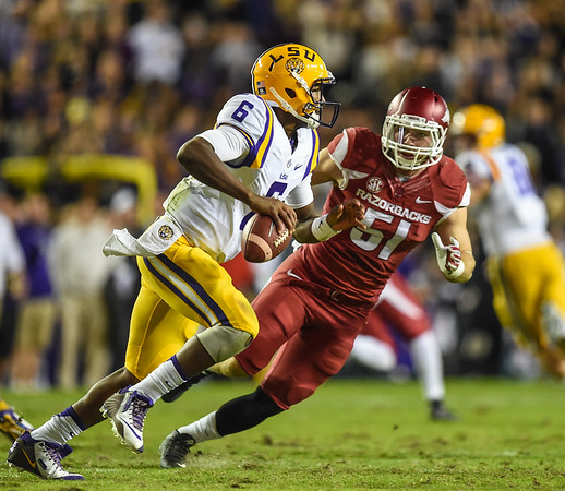 Arkansas Razorbacks linebacker Brooks Ellis (51) pursues LSU Tigers quarterback Brandon Harris (6) during a football game between Arkansas and LSU on November 14, 2015.    (Alan Jamison, Nate Allen Sports Service)