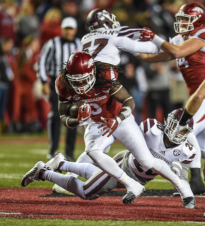 Arkansas Razorbacks running back Alex Collins (3) with a rush during a football game between Arkansas and Mississippi State on November 21, 2015.    (Alan Jamison, Nate Allen Sports Service)