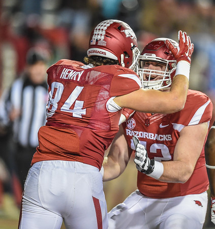 Arkansas Razorbacks tight end Hunter Henry (84) celebrates a touchdown reception with Arkansas Razorbacks offensive lineman Frank Ragnow (72) during a football game between Arkansas and Mississippi State on November 21, 2015.    (Alan Jamison, Nate Allen Sports Service)