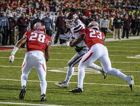 Arkansas Razorbacks linebacker Dre Greenlaw (23) with a tackle during a football game between Arkansas and Mississippi State on November 21, 2015.    (Alan Jamison, Nate Allen Sports Service)
