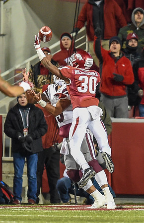 Arkansas Razorbacks defensive back Kevin Richardson (30) breaks up a pass attempt during a football game between Arkansas and Mississippi State on November 21, 2015.    (Alan Jamison, Nate Allen Sports Service)
