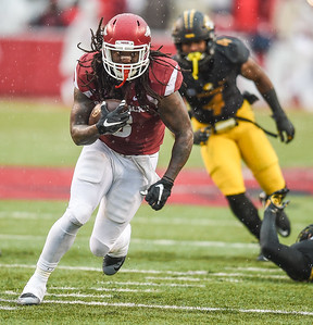 Arkansas Razorbacks running back Alex Collins (3) with a rush during a football game between Arkansas and Missouri on November 27, 2015.    (Alan Jamison, Nate Allen Sports Service)