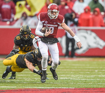 Arkansas Razorbacks quarterback Brandon Allen (10) with a rush during a football game between Arkansas and Missouri on November 27, 2015.    (Alan Jamison, Nate Allen Sports Service)