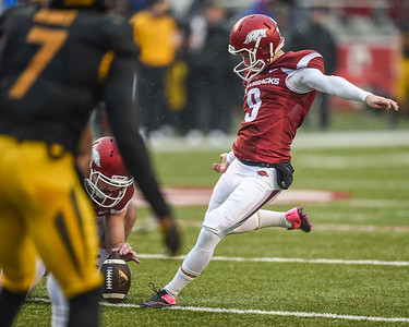 Arkansas Razorbacks place kicker Cole Hedlund (9) with a PAT during a football game between Arkansas and Missouri on November 27, 2015.    (Alan Jamison, Nate Allen Sports Service)