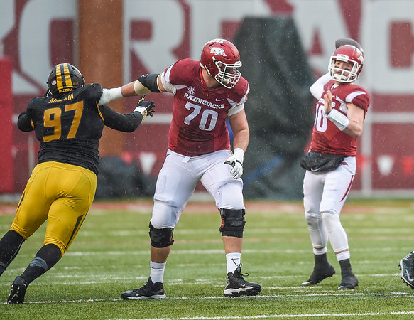Arkansas Razorbacks quarterback Brandon Allen (10) with a pass during a football game between Arkansas and Missouri on November 27, 2015.    (Alan Jamison, Nate Allen Sports Service)