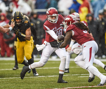 Arkansas Razorbacks quarterback Brandon Allen (10) hands off to Arkansas Razorbacks running back Alex Collins (3) during a football game between Arkansas and Missouri on November 27, 2015.    (Alan Jamison, Nate Allen Sports Service)